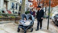 Rabbi Mendel Alperowitz and Mussie Alperowitz walk their two daughters in Crown Heights, Brooklyn. Eliyahu Parypa/Chabad.org