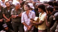 Leonard Cohen, center, performing with Matti Caspi, on guitar, for Ariel Sharon & IDF soldiers in the Sinai in 1973. JTA