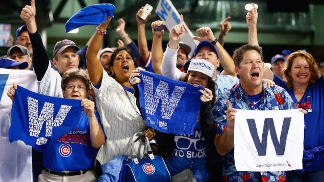 Chicago Cubs fans cheering after their team defeated the Cleveland Indians. JTA