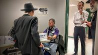 At the Midwood library just off Ave. J in Brooilyn, locals discuss voter qualifications with a poll worker. Amy Sara Clark/JW