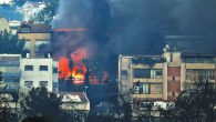 Smoke billows from a house as fire rages in the northern Israeli port city of Haifa last week.