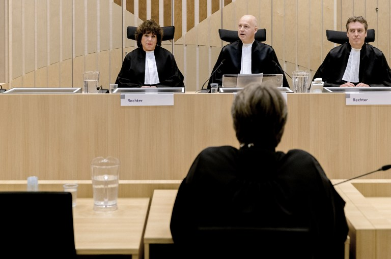 L-R: Judges Elianne van Rens, Henry Steenhuis and Sijbrand Wreath talk before rendering the verdict in the criminal case against populist Dutch MP Geert Wilders of the Party for Freedom (PVV), at Schiphol, Badhoevedorp, in the Netherlands, on December 9, 2016. (AFP PHOTO/ANP/Sander Koning)