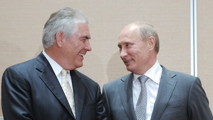 This file photo taken on August 30, 2011 shows Russia's then Prime Minister Vladimir Putin speaking with then ExxonMobil President and CEO Rex Tillerson during the signing of a Rosneft-ExxonMobil strategic partnership agreement in Sochi. (AFP PHOTO/RIA NOVOSTI/ALEXEY DRUZHININ)