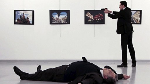 This picture taken on December 19, 2016 shows Andrei Karlov (bottom), the Russian ambassador to Ankara, lying on the floor after being shot by Mevlut Mert Altintas (R) during an attack during a public event in Ankara. (AFP/Hurriyet/Hasim KILIC/Turkey Out)