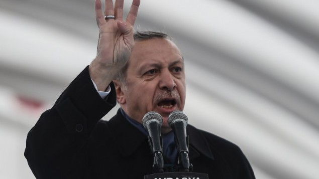 Turkish President Recep Tayyip Erdogan gestures as he delivers a speech on December 20, 2016 in Istanbul, during the opening ceremony of the Avrasya (Eurasia) Tunnel, the first ever road tunnel underneath the Bosphorus Strait in Istanbul from Europe to Asia and the latest project in the Erdogan's plan of transforming Turkey's infrastructure. (AFP PHOTO / OZAN KOSE)