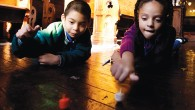 Kids spin dreidels at the Eldridge Street Synagogue on Manhattan's Lower East Side. The game of dreidel was inspired by a German game played at Christmastime.