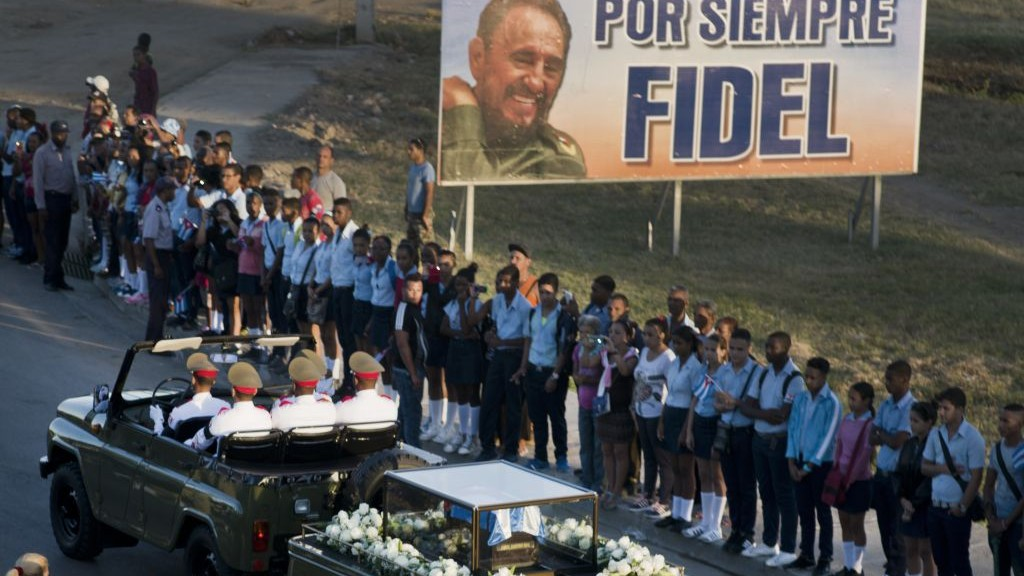 The motorcade carrying the ashes of the late Cuban leader Fidel Castro makes its final journey towards the Santa Ifigenia cemetery in Santiago, Cuba, on Sunday, December 4, 2016. (AP Photo/Ramon Espinosa)