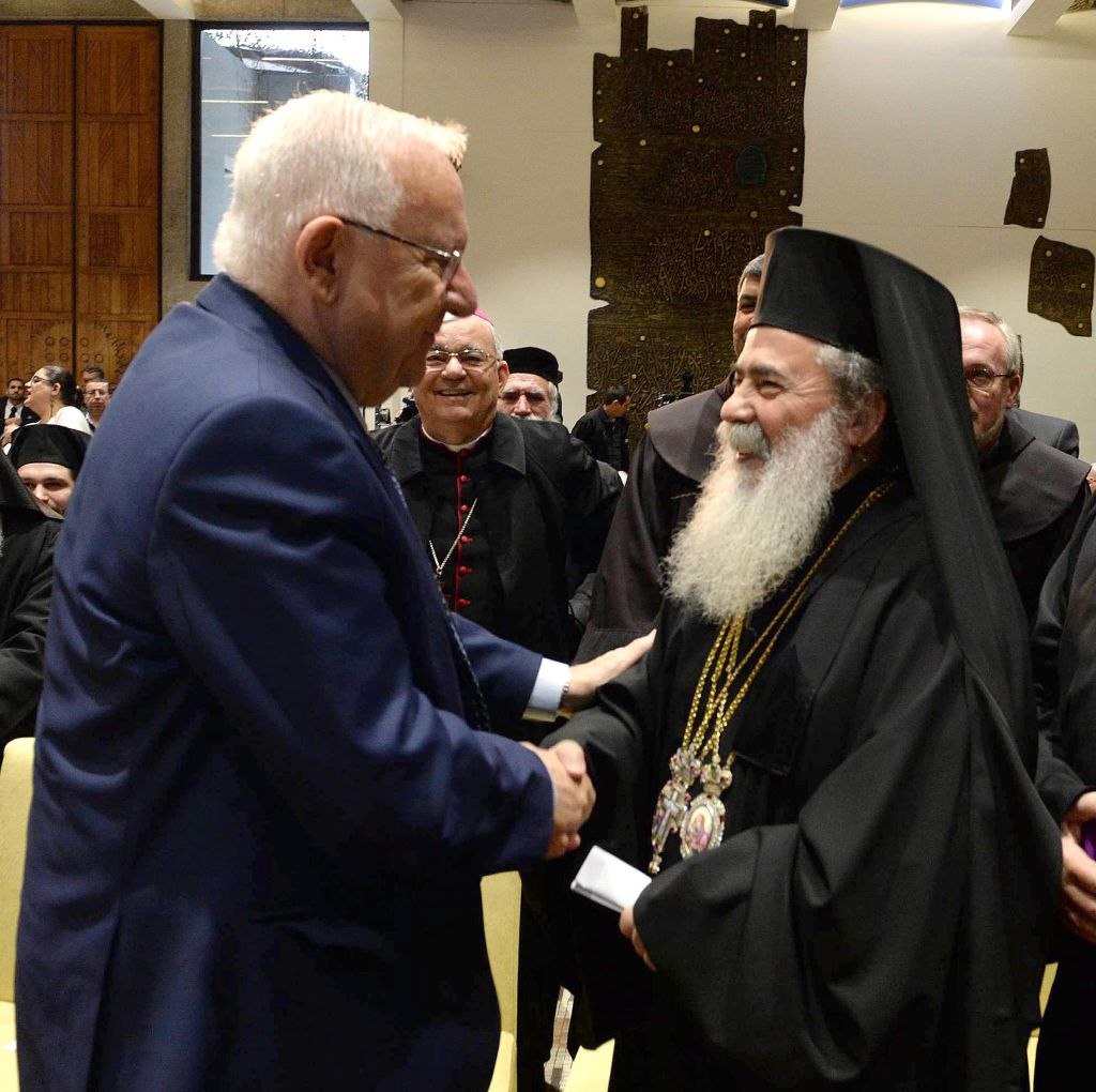 President Reuven Rivlin speaks with Greek Orthodox Patriarch of Jerusalem Theophilos III at his residence in Jerusalem in honor of the upcoming New Year, on December 27, 2016. (Mark Neiman/GPO)