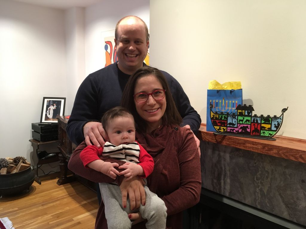 Israelis Benji, Ella, and Eitan (baby) Goldberg get ready to observe Hanukkah -- and Christmas -- this December 24 with Ella's interfaith family in the United States. (courtesy)