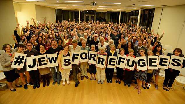 More than 200 attendees pose for a group photo at HIAS' #JewsforRefugees Assembly in New York, Sept 14, 2016.