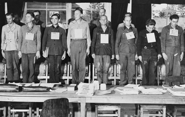 Sixteen of the nineteen defendants on trial for war crimes committed during the war at Dora-Mittelbau. The group included four Kapos. September 17, 1947, Dachau, Germany (US Holocaust Memorial Museum, courtesy of National Archives and Records Administration, College Park)