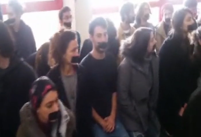 Students at Bezalel Academy of Art and Design in Jerusalem hold a sit-in with their mouths taped shut on December 14, 2016, to protest censorship following a row over images of Prime Minister Benjamin Netanyahu produced at the school (screen capture/ Channel 2)