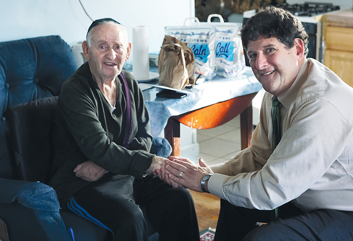 Moshe Strakhman has developed a strong bond with Dennis Gralla, who brings him and his wife food through Kosher Meals on Wheels.