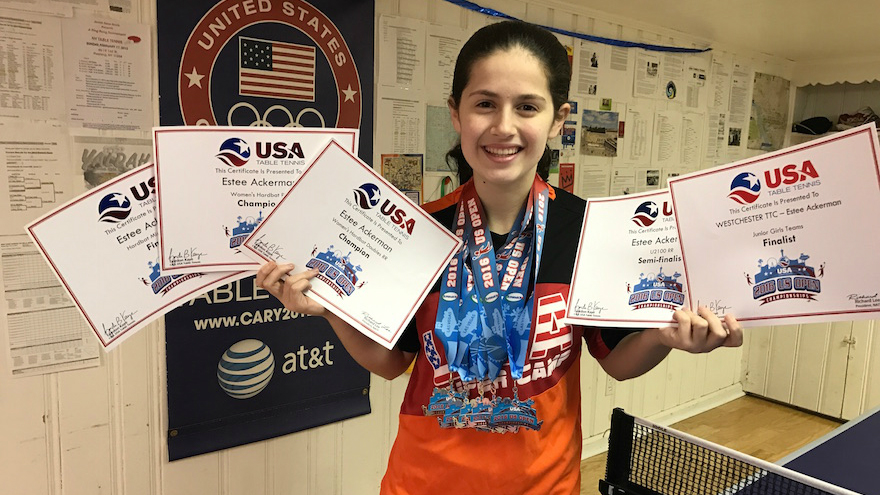 Estee Ackerman holding certificates representing the five medals she won in this month's US Open in table tennis. (Courtesy of Estee Ackerman/via JTA)