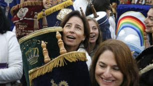 Israeli members of Women of the Wall, carry a Torah scroll during prayers in the women's section of the Western Wall on November 2, 2016. Getty Images