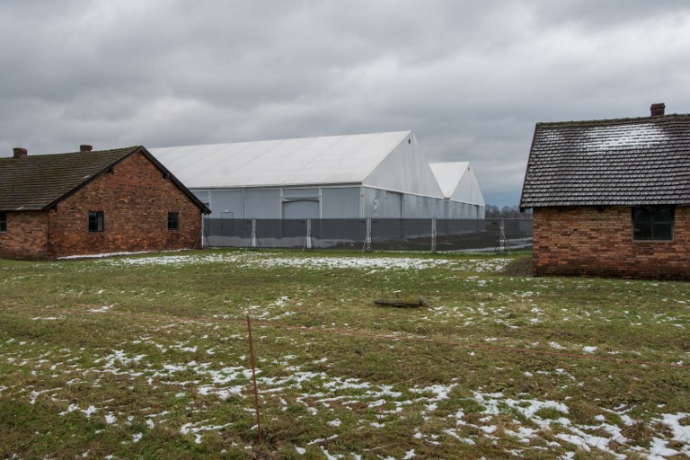 This picture taken on December 2, 2016 in Oswiecim (Auschwitz), Poland, shows barracks at the former Nazi concentration camp. Along with the ruins of the gas chambers and crematoria, the barracks bear witness to Nazi Germany's killing of around 1.1 million people, mostly Jews, at this camp, which it built in 1940 in the southern city of Oswiecim after occupying Poland. (AFP PHOTO / BARTOSZ SIEDLIK)