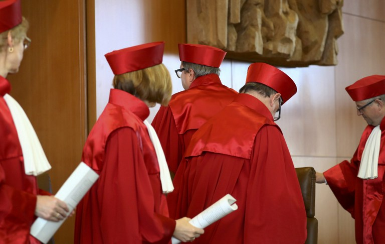 President of Germany's Constitutional Court, Andreas Vosskuhle, and fellow judges leave the room after announcing the rejection of the bid to ban the neo-Nazi poltiical party (Photo Courtesy of the Times of Israel)