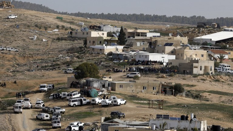 Israeli police gather in the unrecognized Bedouin village of Umm al Hiran in the Negev desert