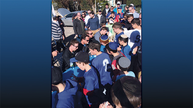 Local kids line up to get autographs of Team Israel players at the groundbreaking for the baseball complex. (Avi Wener)
