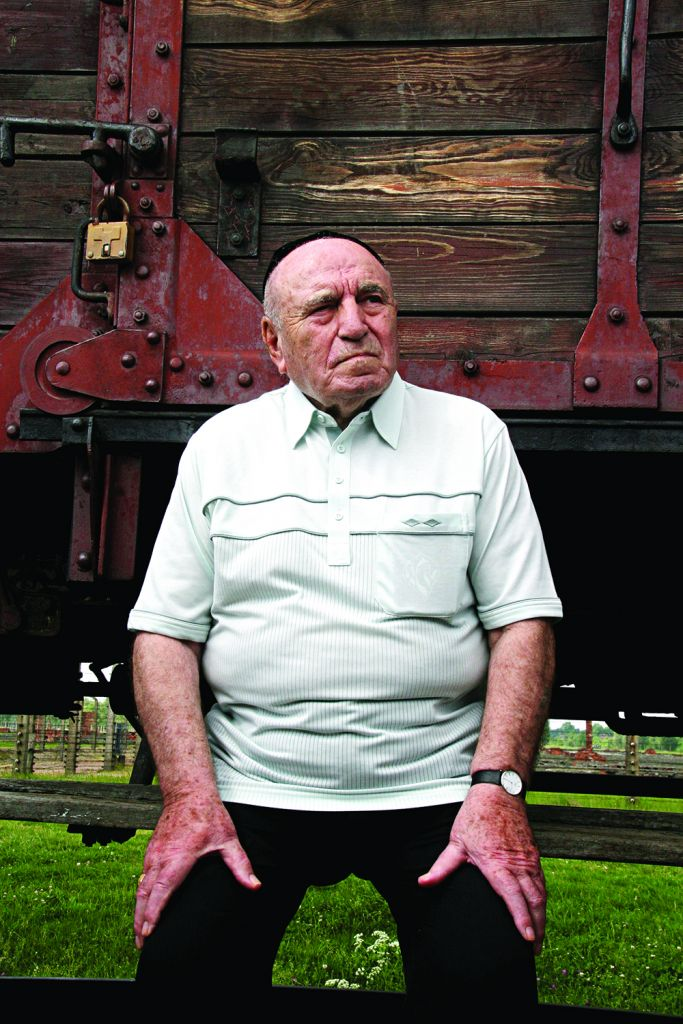Leslie sits shiva for his family on the cattle car in Birkenau on the only spot he has identified as the last place he saw his mother and seven siblings