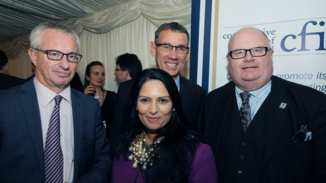 L-R: Stuart Polak, Ambassador Mark Regev and Sir Eric Pickles, with Priti Patel (centre)