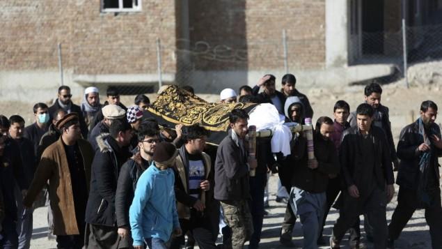 The day after two bombings, men carry the coffin of a relative who died in the attacks, in Kabul, Afghanistan, January 11, 2017. (AP/Rahmat Gul)