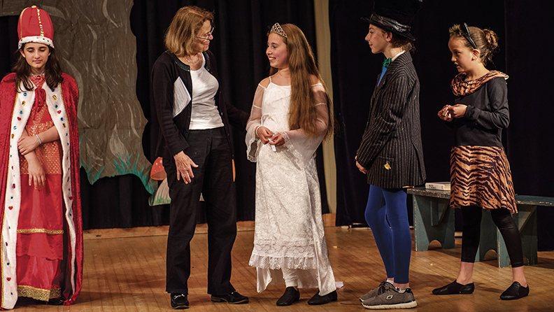 At a Stage Right rehearsal of Alice in Wonderland,  Deb Roberts talks to Noa Lavi, playing the White  Queen, as the Red Queen (Rani Ogden), the Mad Hatter (Avia Paz), and the Cheshire Cat (Liri Raz) look on.