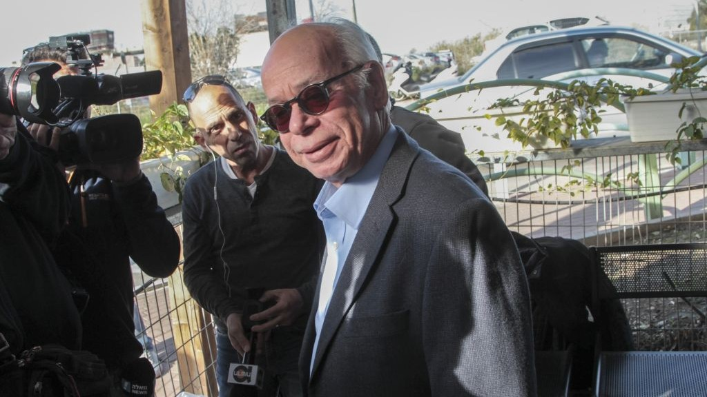 Amos Regev, then chief editor of Israel Hayom daily newspaper arrives for questioning in the so called 'Case 2000' affair at the Lahav 433 investigation unit in Lod, January 17, 2017. (Roy Alima/Flash90)