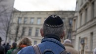 A kippah-clad man man taking part in a silent march in Berlin to commemorate the 75th anniversary of the Kristallnacht pogroms, November 9, 2013. (Carsten Koall/Getty Images)