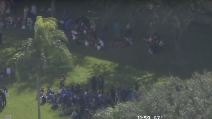 Screen capture of video showing people evacuated from a Jewish community center following a bomb hoax in Miami, Florida, January 9, 2017. (screen capture: YouTube/CBS Miami)