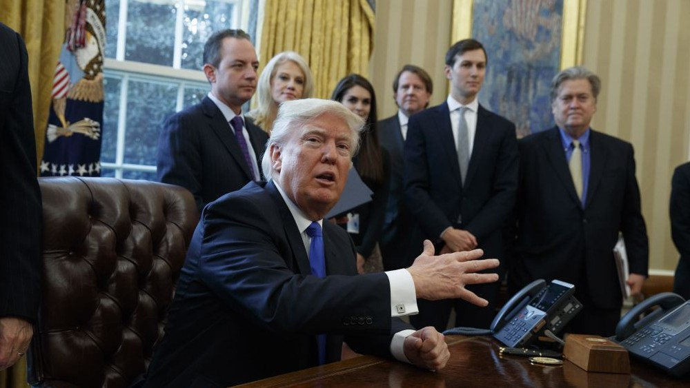President Donald Trump talks with reporters in the Oval Office of the White House in Washington, Tuesday, Jan. 24, 2017, before signing an executive order on the Keystone XL pipeline. (AP/Evan Vucci)