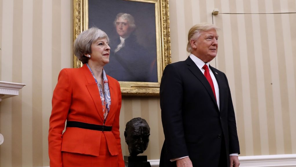 US President Donald Trump stands with British Prime Minister Theresa May next to a bust of former British prime minister Winston Churchill on Friday, Jan. 27, 2017, in the Oval Office of the White House in Washington. (AP Photo/Pablo Martinez Monsivais)