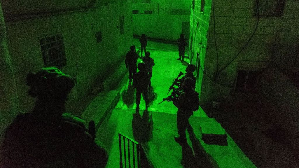 IDF troops make a late-night arrest in the West Bank on January 11, 2017. (IDF Spokesperson's Unit)