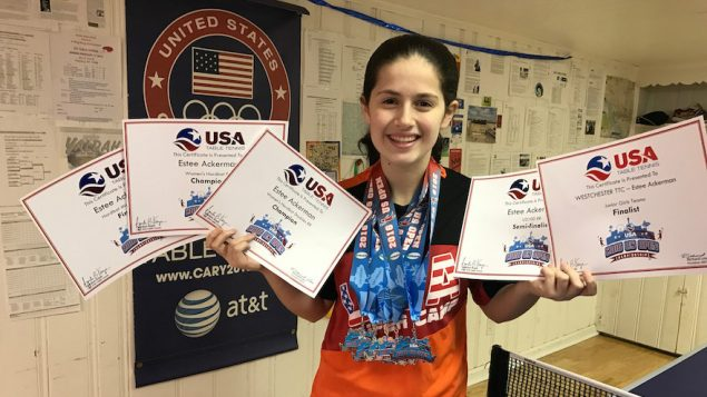 Estee Ackerman holding certificates representing the five medals she won in this month's U.S. Open in table tennis.