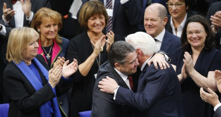 New elected German President Frank Walter Steinmeier is congratulated by German Vice Chancellor and Foreign Minister Sigmar Gabriel after the presidential election at the Bundesversammlung federal assembly Bundestag on Febr