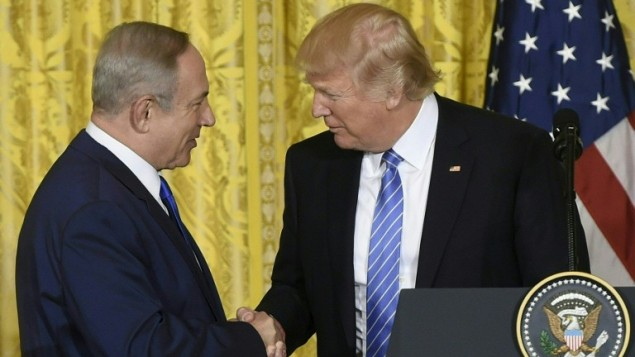 US President Donald Trump and Israeli Prime Minister Benjamin Netanyahu shake hands during a joint press conference at the White House in Washington, DC on February 15, 2017, where both leaders refused to commit to the two-state model as a solution to the Israeli-Palestinian conflict. (Saul Loeb/AFP)
