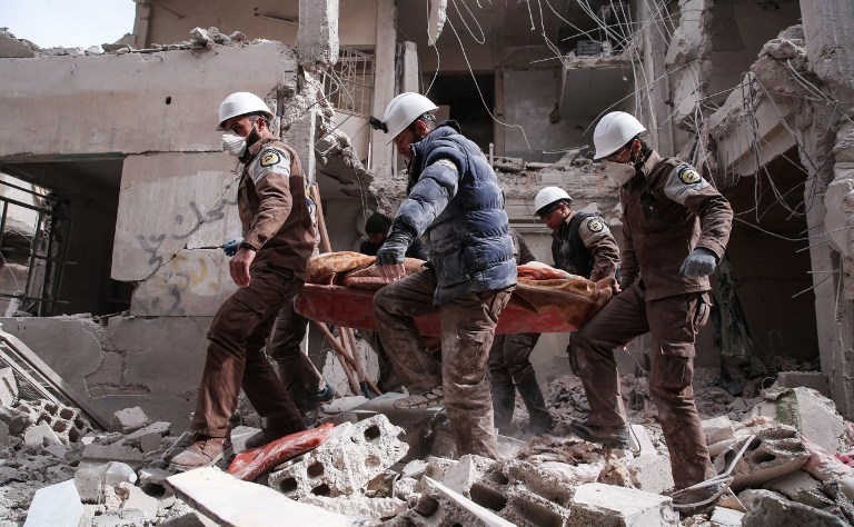 Syrian civil defense volunteers, known as the White Helmets, search for survivors following reported government airstrike on the rebel-held neighborhood of Tishrin, on the northeastern outskirts of the capital Damascus, on February 22, 2017. (Msallam Abdalbaset/AFP)