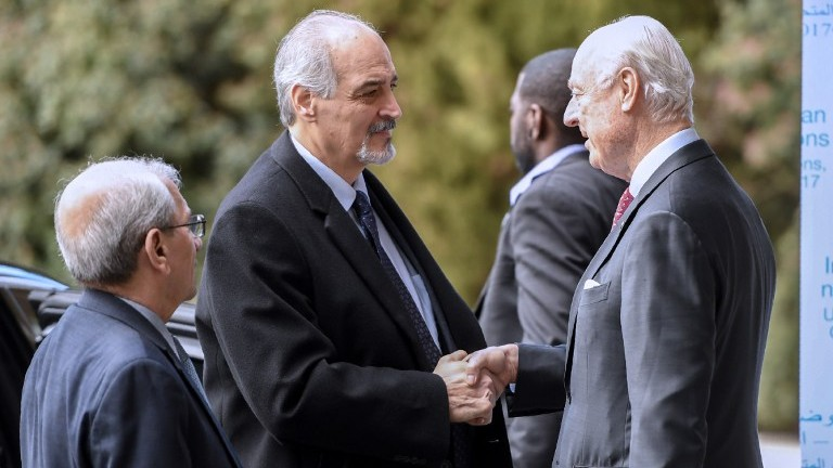 Syrian UN Ambassador Bashar Jaafari shakes hand with UN Syria envoy Staffan de Mistura upon his arrival to take part in the second day of a new round of Syria peace talks