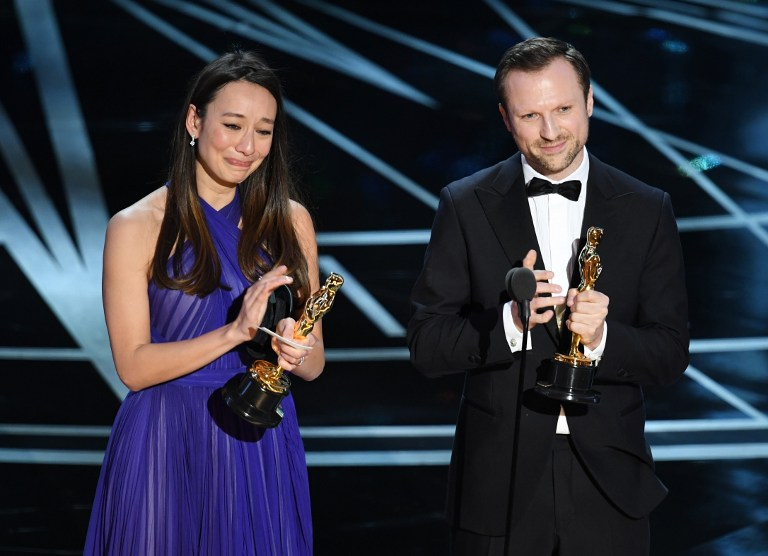 Producer Joanna Natasegara (L) and director Orlando von Einsiedel accept Best Documentary Short Subject for 'The White Helmets' onstage during the 89th Annual Academy Awards at Hollywood & Highland Center on February 26, 2017 in Hollywood, California. (Kevin Winter/Getty Images/AFP)