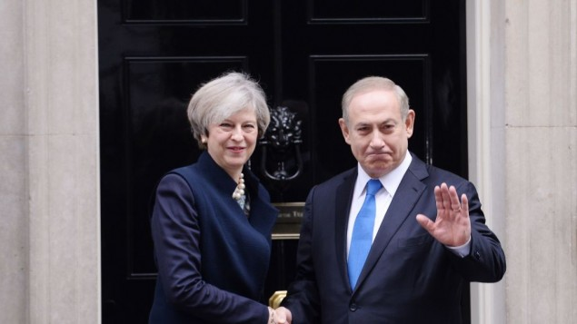 Prime Minister Theresa May greets Israeli Prime Minister Benjamin Netanyahu as he arrives in Downing Street, (Photo credit: Stefan Rousseau/PA Wire)