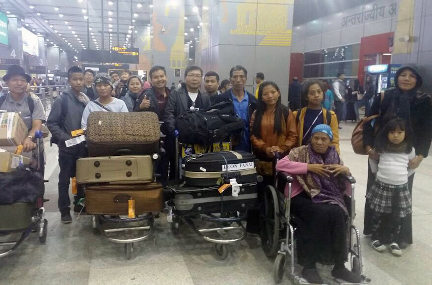 "Members of the ""Bnei Menashe"" Jewish community at the Indira Gandhi International Airport in New Delhi, India, en route to Israel, Feb. 13, 2017. (Shavei Israel)"