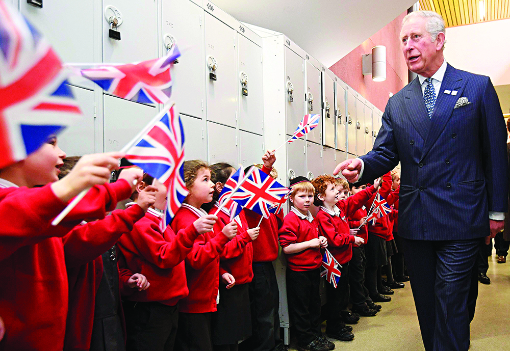 The Prince of Wales is greeted by pupils during his visit to Yavneh College, an Orthodox Jewish school in Borehamwood, Hertfordshire.