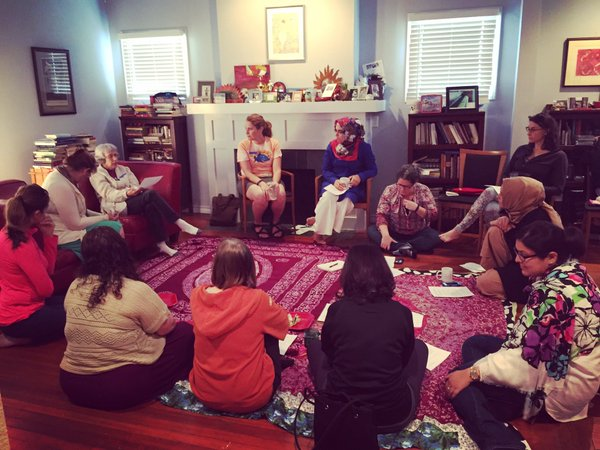 Members of a local Salaam Shalom chapter meet in one member's living room to speak and bond. Courtesy of Salaam Shalom.