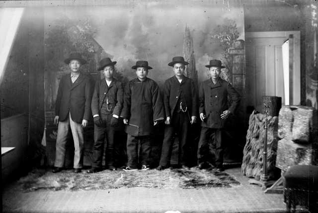 Chinese-American men, circa 1900, dressed in the fashion of the time. (Public domain)