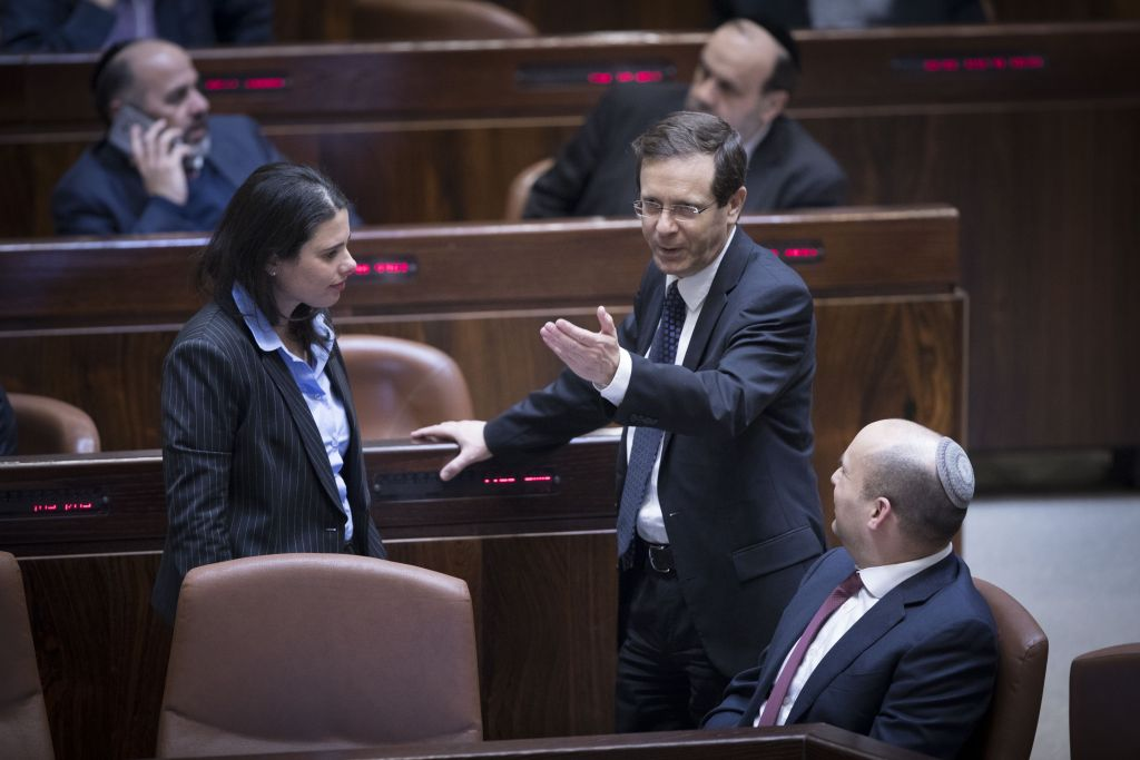 Jewish Home party leader Naftali Bennett (right), party colleague and Minister of Justice Ayelet Shaked and leader of the opposition Isaac Herzog seen in the Knesset just prior to the passage of the Regulation Law, which retroactively legalizes outposts built in the West Bank. (Yonatan Sindel/Flash90)
