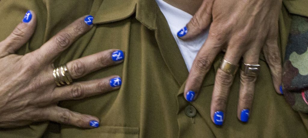 "A closeup of the fingernails of Elor Azaria's mother, Oshrat, during his sentencing hearing on February 21, 2017. The Hebrew letters spell out ""mother's hero."" (Jim Hollander/POOL)"