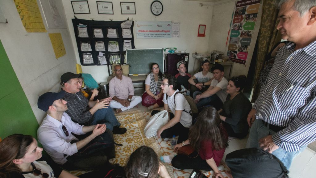 Group debriefing in the Kalwa slum, with Jacob Stockman, founder and director of the Gabriel Project Mumbai. (Courtesy)