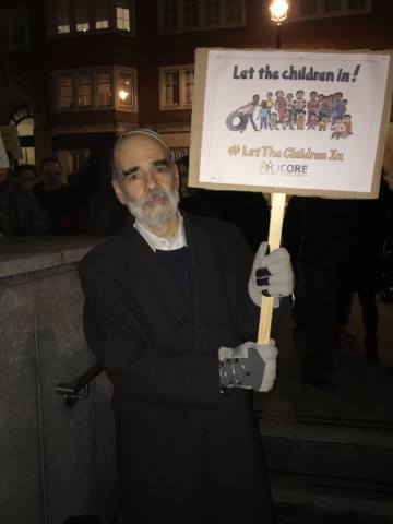 Rabbi Jonathan Wittenberg pictured with placard