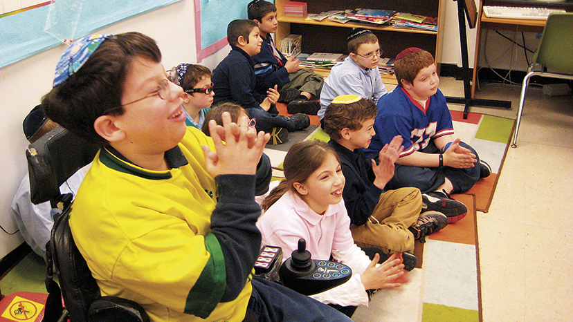 Jacob Adler and his Sinai classmates sit together in a classroom at the Joseph Kushner Hebrew Academy.
