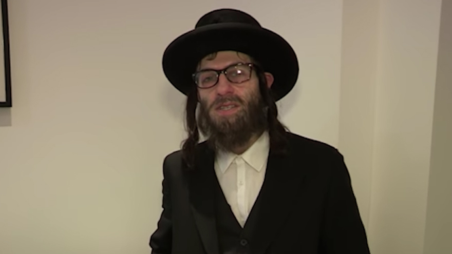 "Simon Brodkin dressed as a haredi Orthodox rabbi for an audition for ""Britain's Got Talent."" (Screenshot from YouTube/via JTA)"